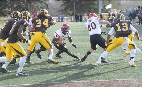 Muema runs with the ball