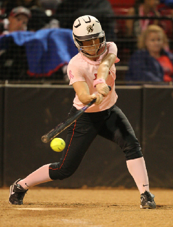 Senior catcher Kristin May swings and connects with the ball vs. Utah State. (Stan Lui)