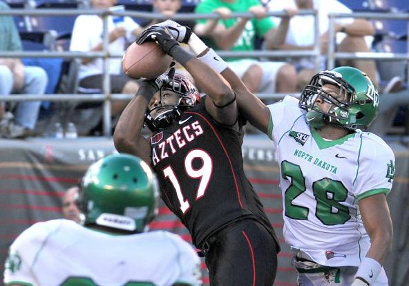 Brice Butler hauls in a touchdown during the 2012 season. (Ernie Anderson)